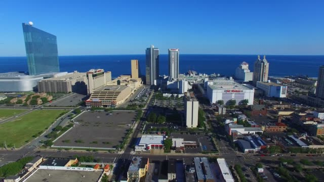 Aerial footage of several vignettes over Atlantic City NJ on Monday July 11 Shots Gliding Pan shot with a hook revealing Harrahs Waterfront Tower on...