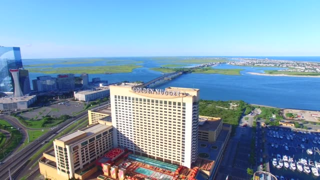 Aerial footage of several vignettes over Atlantic City NJ on Monday July 11 Shots Gliding Pan shot R TO L revealing Harrah's Waterfront Tower and the...