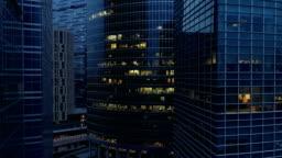 Aerial footage of skyscraper at night. 4K.