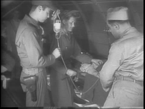 aerial footage of solomon islands / line of ambulance nurses closeups / first american women to land on guadalcanal / nurses put wounded into douglas... - pazifikinseln stock-videos und b-roll-filmmaterial