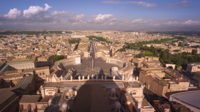 Aerial footage of St. Peter's plaza and the rooftops of Rome