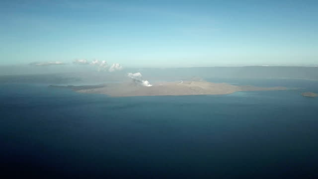 aerial footage of steaming crater of taal volcano after major eruption - taal volcano stock videos & royalty-free footage