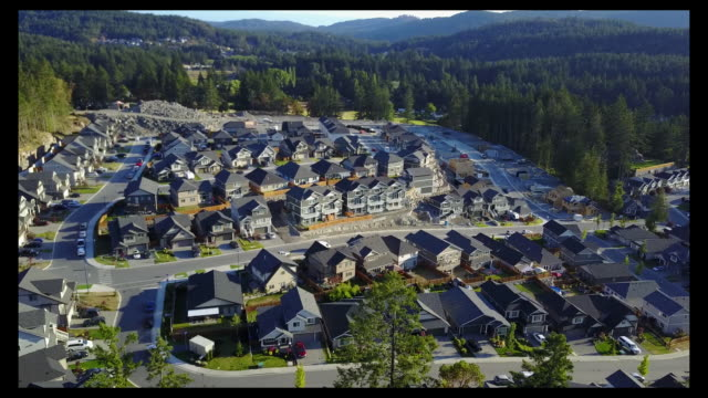 aerial footage of suburban growth new suburban residential construction in langford, a suburb of victoria, british columbia, canada on saturday, july... - カナダ ビクトリア市点の映像素材/bロール