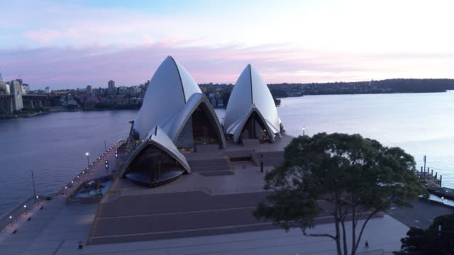 aerial footage of sunrise at the sydney opera house during covid-19 restrictions on saturday april 18, 2020. the iconic sydney opera house as the sun... - lockdown stock videos & royalty-free footage