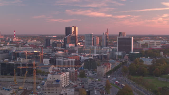 Aerial footage of Tallinn City sunset with old chimney in foreground