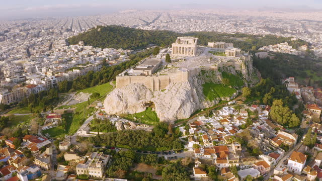 aerial footage of the acropolis and the old town of athens, greece - parthenon athens stock videos & royalty-free footage
