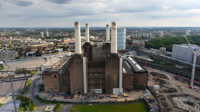 aerial footage of the battersea power station and london shot on september 16 2014 in london england - バタシー発電所点の映像素材/bロール