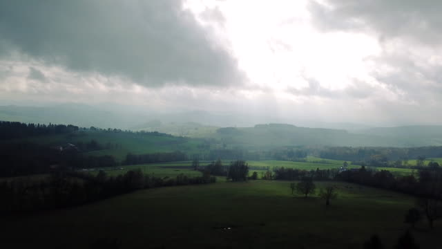 Aerial footage of the bio-preservation area Rhön, Germany, under dramatic skies