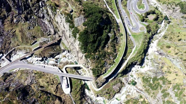 vidéos et rushes de aerial footage of the gotthard pass road in the alps in canton uri in switzerland - switzerland