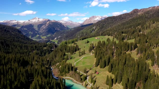 aerial footage of the iselsee lake in arosa in the alps in canton graubünden in switzerland - cultures stock videos & royalty-free footage