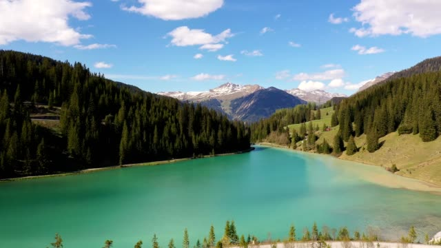 aerial footage of the iselsee lake in arosa in the alps in canton graubünden in switzerland - purity stock videos & royalty-free footage