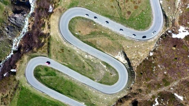 aerial footage of the julier mountain pass road in graubunden, switzerland - biegung stock-videos und b-roll-filmmaterial