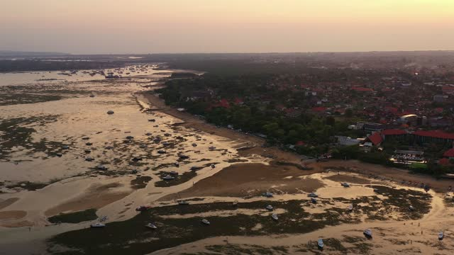 aerial footage of the low tide in sanur beach in bali, indonesia - low tide stock videos & royalty-free footage