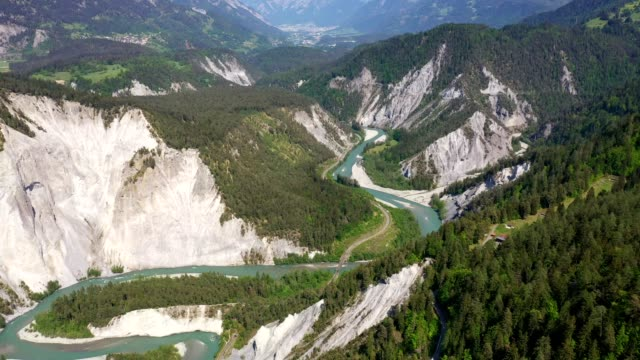 aerial footage of the rhine gorge, or the grand canyon of switzerland in canton graubünden - river stock videos & royalty-free footage