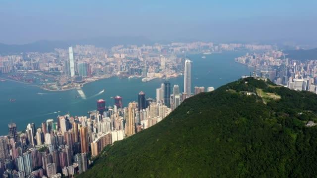 aerial footage of the summit of the victoria peak in hong kong island - berg victoria peak stock-videos und b-roll-filmmaterial