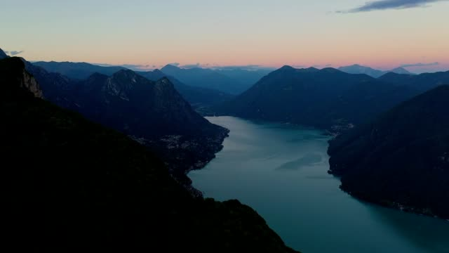aerial footage of the sunset of lake lugano and the swiss alps in switzerland - european alps stock videos & royalty-free footage