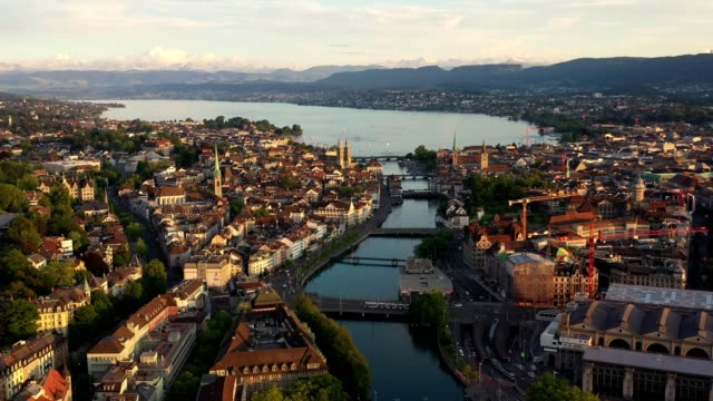 aerial footage of the sunset over zurich old town in switzerland - switzerland stock videos & royalty-free footage