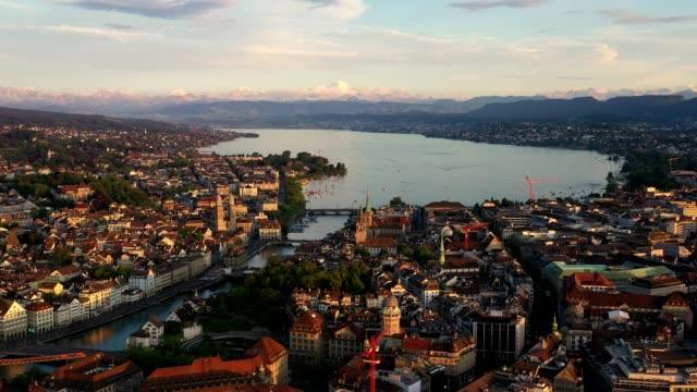 vidéos et rushes de aerial footage of the sunset over zurich old town in switzerland - ligne de tramway