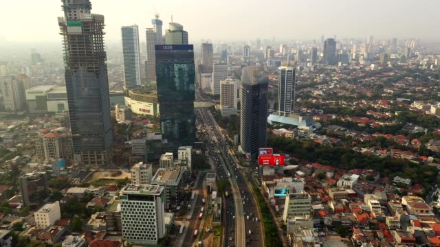 aerial footage of the traffic in the heart of jakarta business district in indonesia - aerial stock videos & royalty-free footage