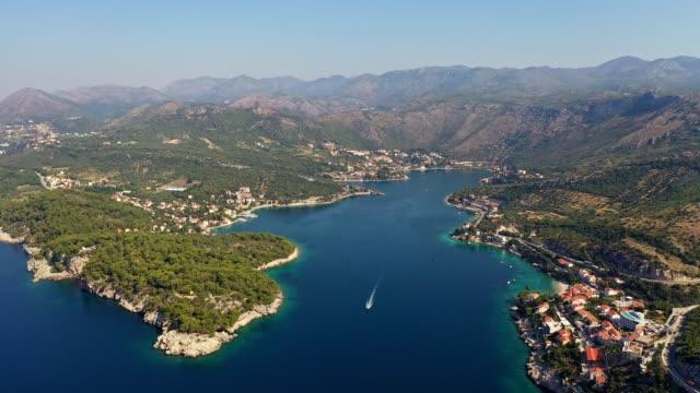 aerial footage of the zaton bay near dubrovnik in croatia - andersherum stock-videos und b-roll-filmmaterial