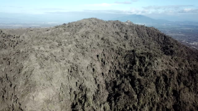 aerial footage of thick volcanic ash deposits after major eruption at taal volcano - taal volcano stock videos & royalty-free footage