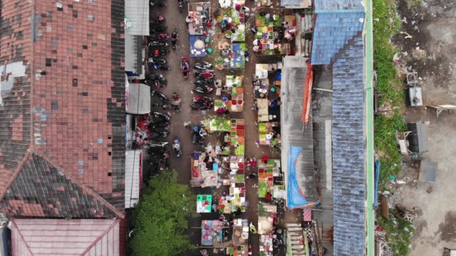 aerial footage of traditional market in indonesia during pandemic covid-19 - indonesia stock videos & royalty-free footage