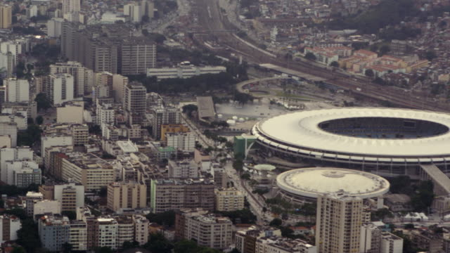 stockvideo's en b-roll-footage met aerial footage of urban rio, including football stadium - rio de janeiro
