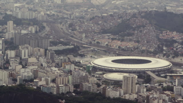 Aerial footage of urban Rio, including soccer stadium