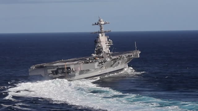 aerial footage of uss gerald r. ford conducting high speed turns during sea trials in the atlantic ocean. - aircraft carrier stock videos & royalty-free footage