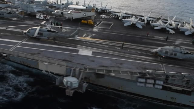 aerial footage of uss ronald reagan , the flagship of carrier strike group 5, provides a combat-ready force that protects and defends the collective... - aircraft carrier stock videos & royalty-free footage