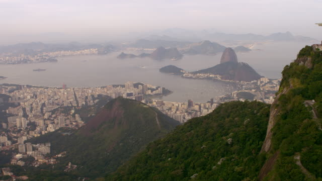 vídeos de stock, filmes e b-roll de aerial footage of various cities, shorelines, and landmarks - rio de janeiro, brazil. - ponto de referência natural