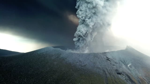 Aerial footage of volcanic eruption at Shinmoedake crater at Kirishima volcano in Japan
