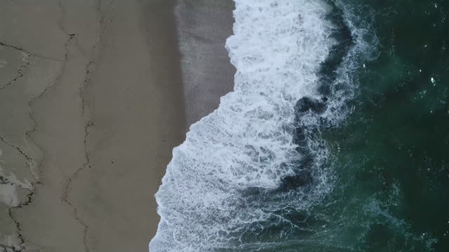 aerial footage of waves rolling on shore at beach, tayrona national park, colombia - tayrona national park stock videos and b-roll footage