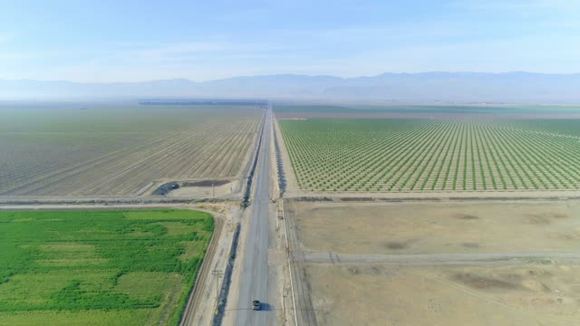 aerial footage over country road in the farm lands of  california - convertible overhead stock videos & royalty-free footage