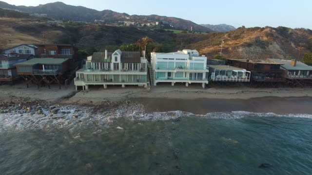 aerial footage over malibu houses on the beach - beach house stock videos & royalty-free footage