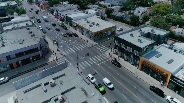 aerial footage over melrose avenue shopping district in los angeles - local landmark stock videos & royalty-free footage