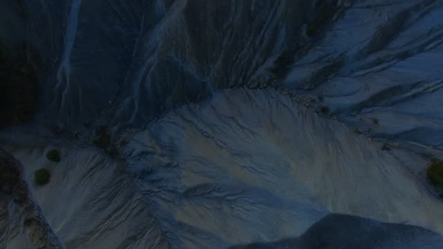 aerial footage recorded with drone flying over a stunning mountain formation created by erosion with nice pattern and monument formation. - 30 seconds or greater stock videos & royalty-free footage
