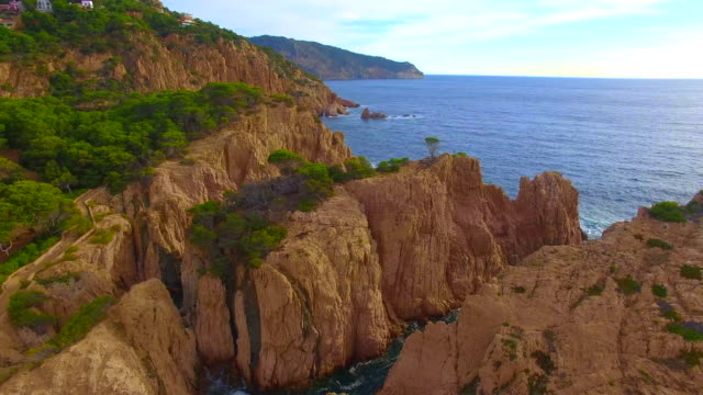 Aerial footage recorded with drone flying over a stunning rock formations in the Costa Brava Mediterranean Sea during sunrise wit nice colors and stunning landscape. 4K UHD.