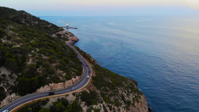aerial footage recorded with drone flying over a traffic road in the coast with cliffs. - spain stock videos & royalty-free footage