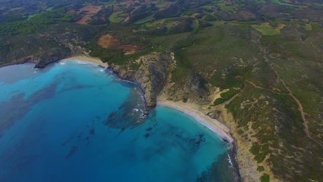 Aerial footage recorded with drone flying over the Menorca island with beautiful turquoise water beach, a paradise island in the Mediterranean Sea. 4K UHD.