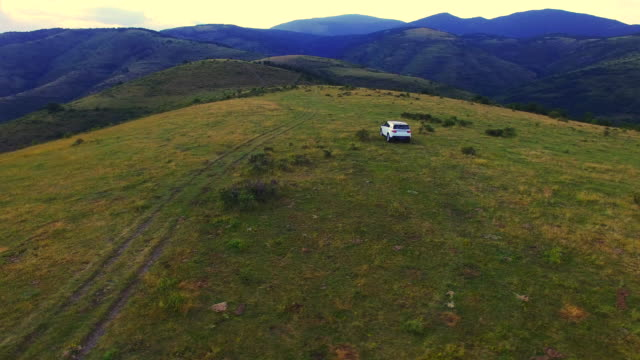 aerial footage recorded with drone of a family with suv 4x4 car driving off road in the beautiful mountains of the catalan pyrenees on sunset light during a summer road trip discovering amazing places. 4k uhd. - sports utility vehicle stock videos and b-roll footage