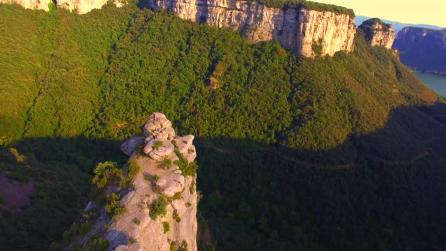 Aerial footage recorded with drone of the natural cliffs mountains with beautiful landscape in the Tavertet mountains, a vertical hills with amazing views. UK UHD.