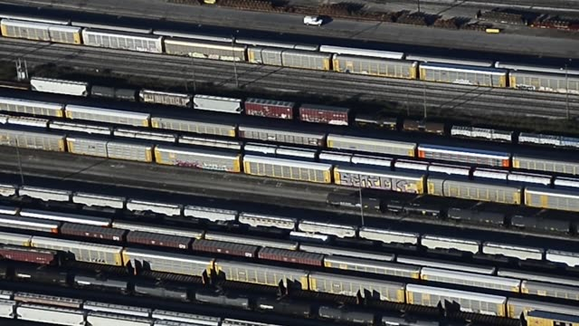 aerial footage showing a railyard and many trains in toronto in ontario canada on october 2 photographer james macdonald - 操車場点の映像素材/bロール