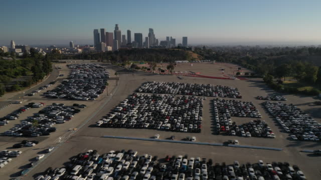 aerial footage showing rental cars stored in parking lot at dodger stadium, los angeles, california, u.s., on wednesday, may 27, 2020. hertz global... - car park stock videos & royalty-free footage