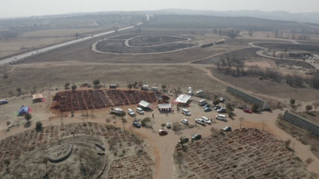 aerial footage shows funerals under way at the olifantsvlei cemetery in soweto, as south africa's covid-19 death toll continues to rise - funeral stock videos & royalty-free footage