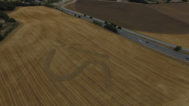 Aerial footage taken with drone flying over a huge SI (YES) marked in the agriculture field next to highway asking for vote yes in the independence referendum of Catalonia in the October of 2017.