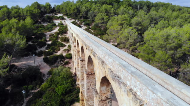aerial footage taken with drone of the beautiful tarragona roman bridge. - aqueduct stock videos and b-roll footage