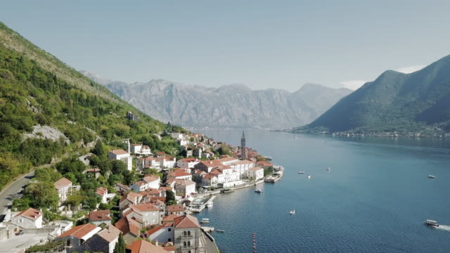 aerial forward: a sunny day at the docks of perast montenegro - perast stock videos and b-roll footage
