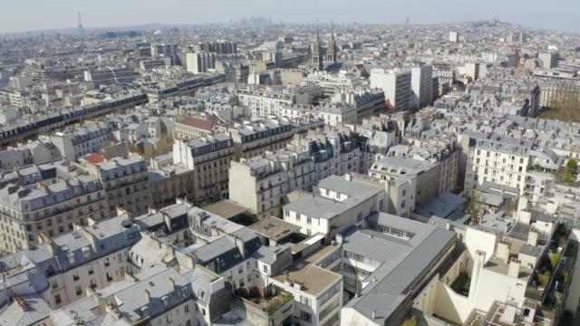 aerial forward: amazing church among neat houses with eiffel tower in the distance - paris, france - eiffel tower paris stock videos & royalty-free footage