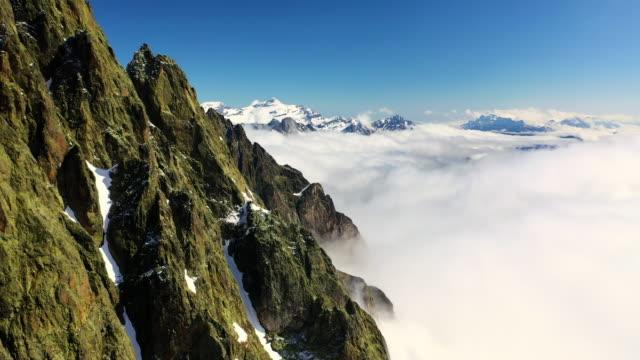 aerial forward: amazing sunlit snowy mountain peak - mount blanc, france - mont blanc stock videos & royalty-free footage